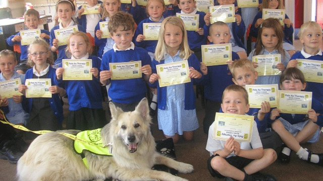 Amber the reading dog and pupils