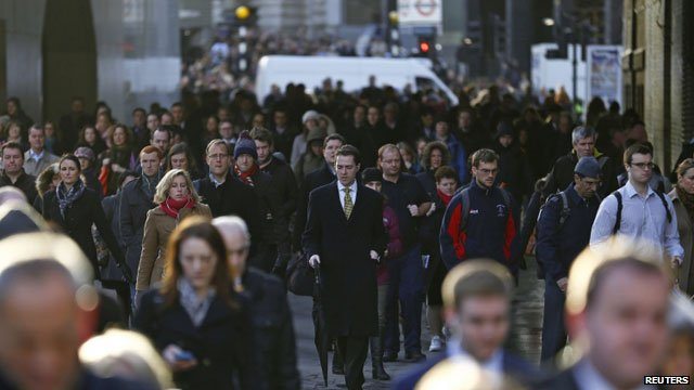 Commuters walk to work