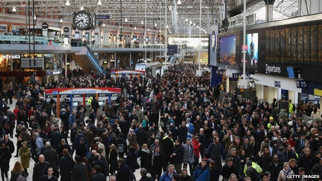 Commuters wait for trains at Waterloo
