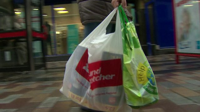 Shopper with plastic bags