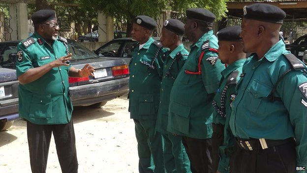 Jibrin Danlami Hassan (left) speaks to police colleagues. Mr Hassan is leading the local Islamic police campaign against homosexuals in Bauchi