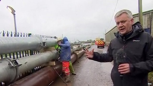 Chris Eakin looks at the emergency pipes pumping floodwater away from the village of Moorland