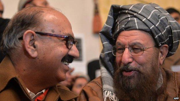 Chief government negotiator Irfan Siddiqui (L) and Taliban team head Maulana Sami ul-Haq