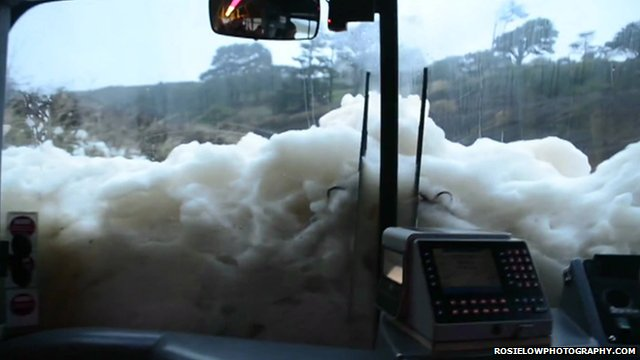 Foam enveloping in Poldhu beach in Mullion, Cornwall