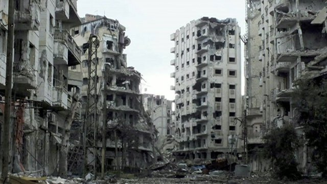 Badly damaged buildings in Homs