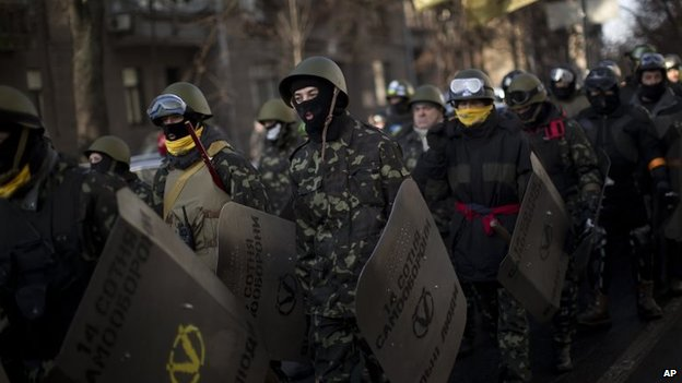 Opposition supporters march toward the parliament in Kiev, Ukraine, Thursday, Feb. 6, 2014.