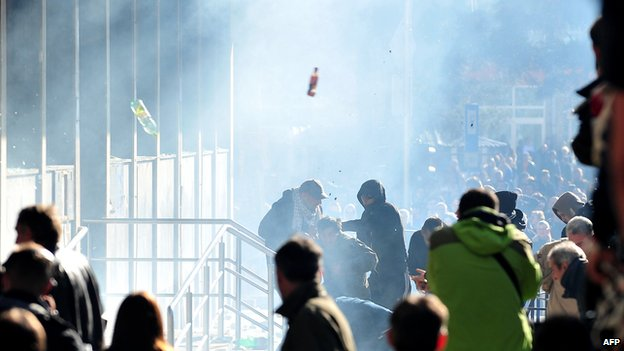 Protesters storm a local government building in the northern Bosnian town of Tuzla on February 7, 2014