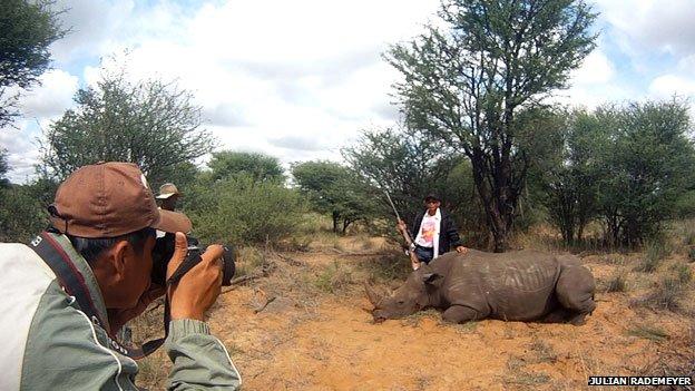 Vietnamese hunter with dead rhino