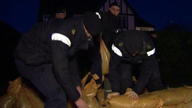 Royal Navy personnel build sandbag wall