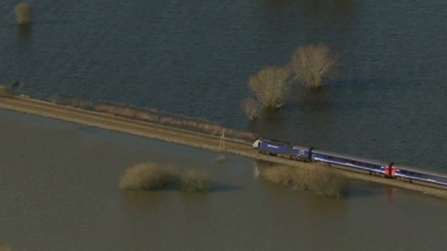 Train on track next to floods
