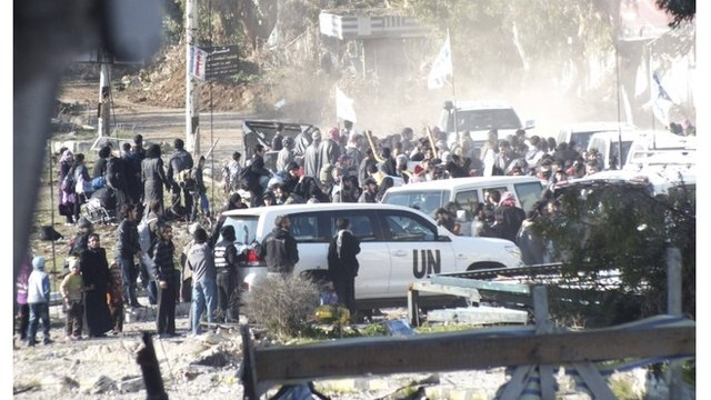 Syrians flee Homs