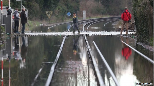 The floods at Datchet move across rail lines