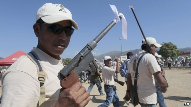 Armed residents take part in a march for the first anniversary of the citizen's vigilante groups, in Ayutla de los Libres, on January 5, 2014, in the south-eastern state of Guerrero, Mexico