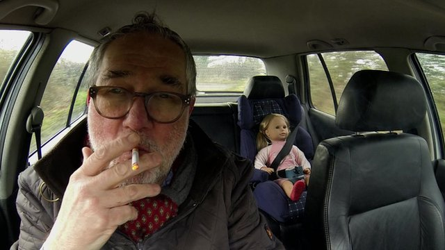 Smoker with dummy and detector in back of a car