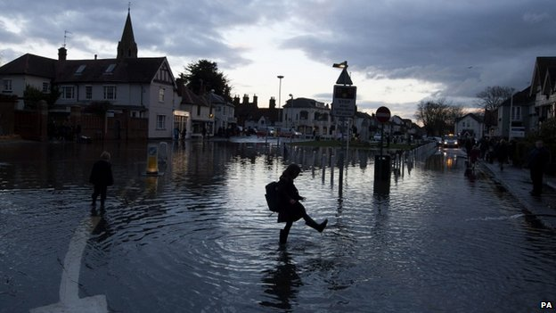 A child playing in flood water in Datchet, Berkshire