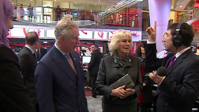 Presenter Ros Atkins talking to Prince Charles and the Duchess of Cornwall on visit to New Broadcasting House