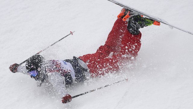 Devin Logan slides on her stomach during Women's ski slopestyle final