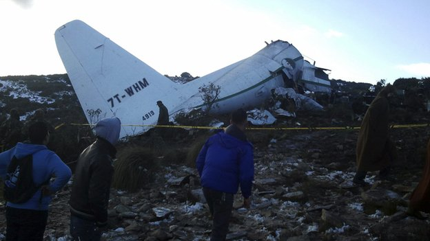 A crashed military plane is pictured in Oum El Bouaghi province, about 500km (311 miles) from the capital Algiers on 11 February 2014.