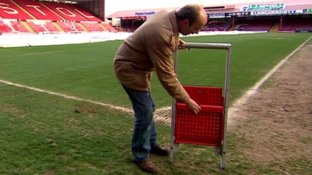 Jon Darch demonstrates new stadium safe standing seat