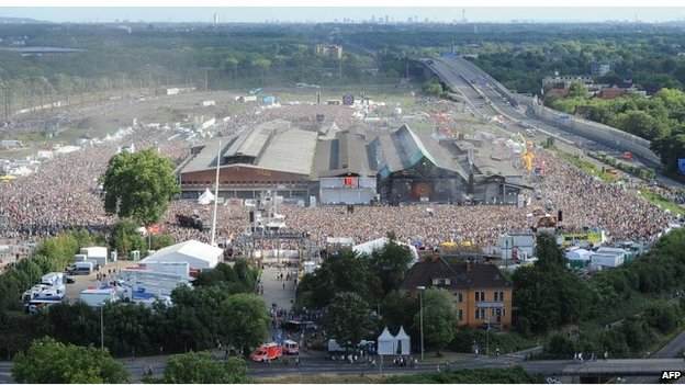 Aerial view of the vast crowd at the festival site, a former freight area, in Duisburg, western Germany.