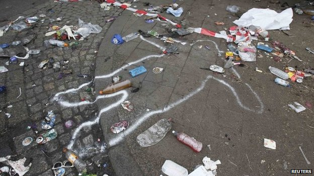 The position of a victim of a deadly stampede is marked on the street between two tunnels in Duisburg in this 25 July 2010 file photo
