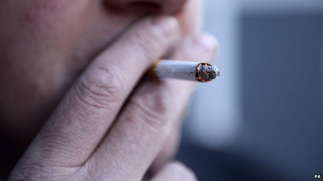 A man smoking a cigarette