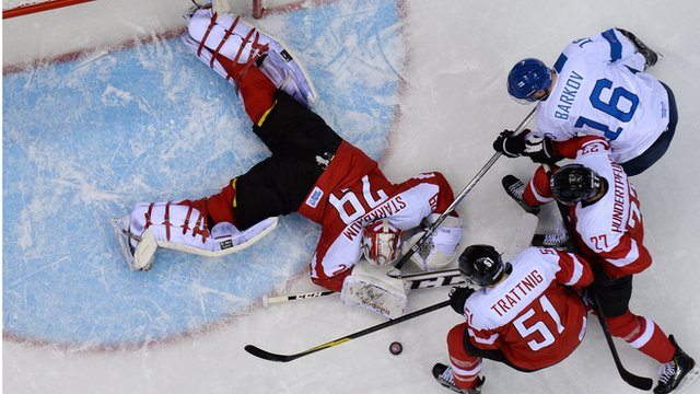 Finland versus Austria in the men's ice hockey competition at Sochi 2014
