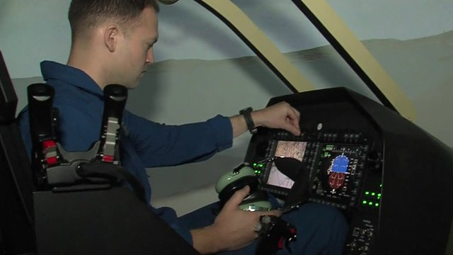 man in helicopter simulator
