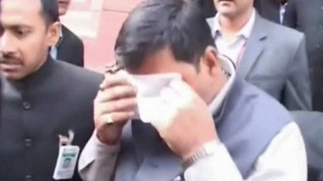 Man wiping eyes with hankerchief