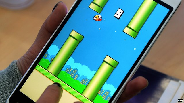 A person playing mobile app Flappy Bird
