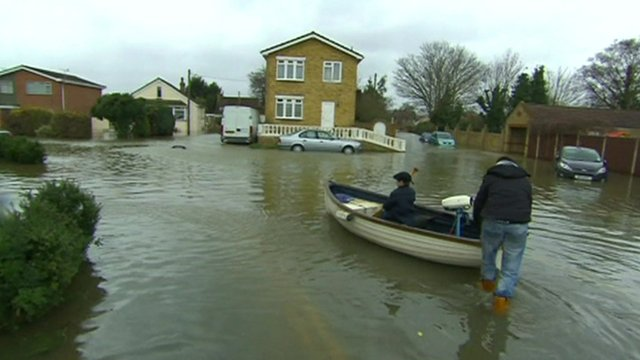 A boat on a flooded street