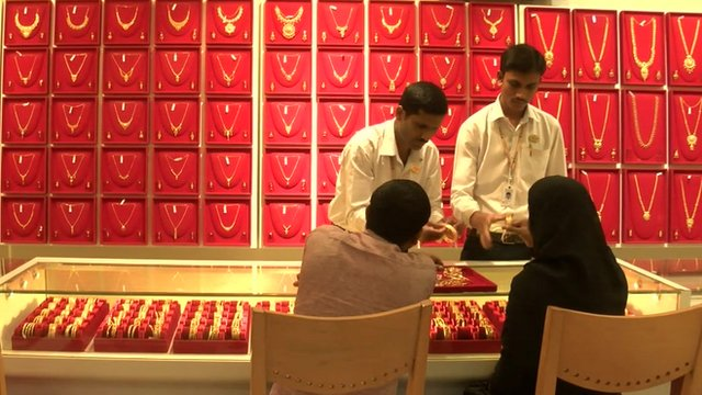 Gold salesmen in Bangalore, India, showing jewellery to two customers