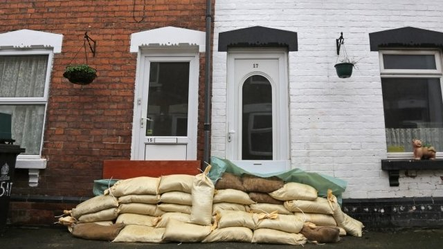 House protected by sandbags