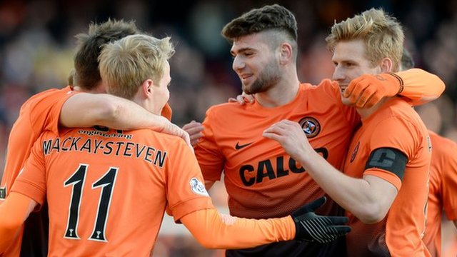 Gary Mackay-Steven is congratulated by teammates after firing Dundee United ahead