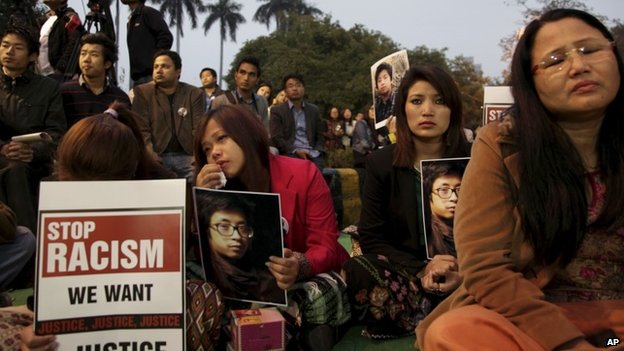 Supporters of Nido Tania, a 20-year-old university student, hold up his portrait as they gather to seek justice at Jantar Mantar in New Delhi, India Saturday, Feb. 15, 2014.