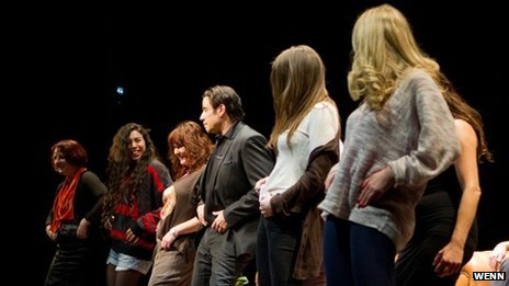 John Travolta teaches audience members to dance
