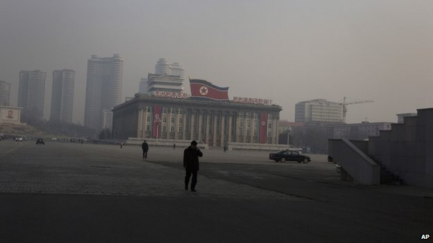 North Korean people walk through Kim Il Sung Square in Pyongyang, North Korea, Sunday, 16 February 2014