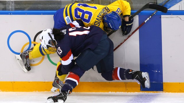 Big tackle in the women's ice hockey semi-final between USA and Sweden at Sochi 2014