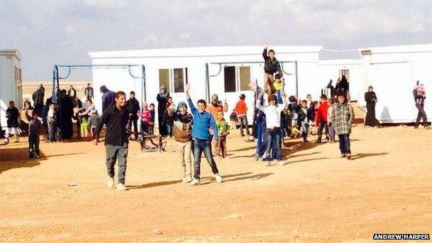 Smiling Syrian refugee children just inside the Jordanian border