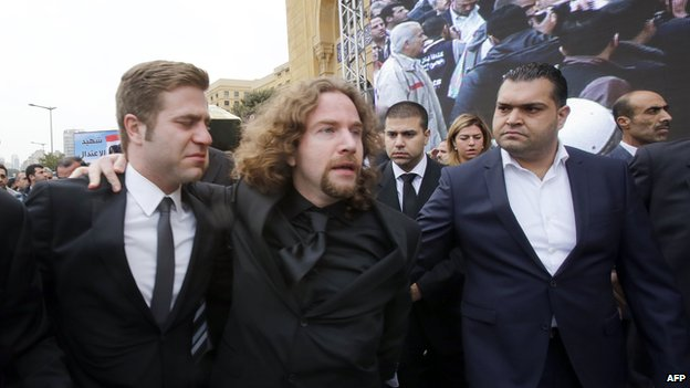 Ronnie Shatah (centre) at his father's funeral