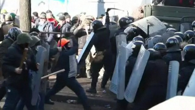 Protesters and riot police square off