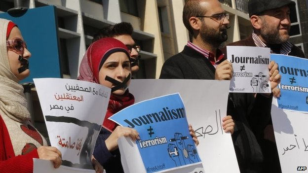 Activists and journalists take part in a demonstration in support of the al-Jazeera staff, who have been detained by Egyptian authorities since last year, in the Lebanese capital Beirut on 8 February 2014