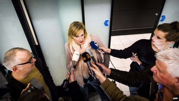 """Dutch journalist Rena Netjes arrives at Schiphol Airport in the Netherlands on 4 February 2014, after being accused by Egypt of being part of a """"terror cell"""" involving broadcaster al-Jazeera"""