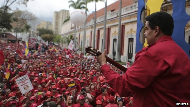 Venezuela's President Nicolas Maduro plays a cuatro during a rally in Caracas February 18, 201