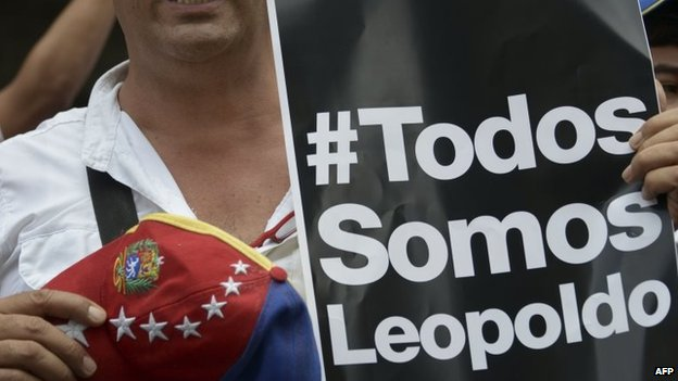 A supporter of Leopoldo Lopez attends a march on 18 February, 2014, in Caracas
