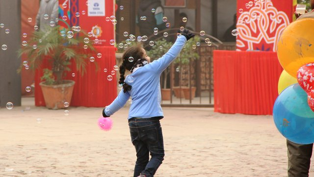Girl playing with bubbles in Delhi