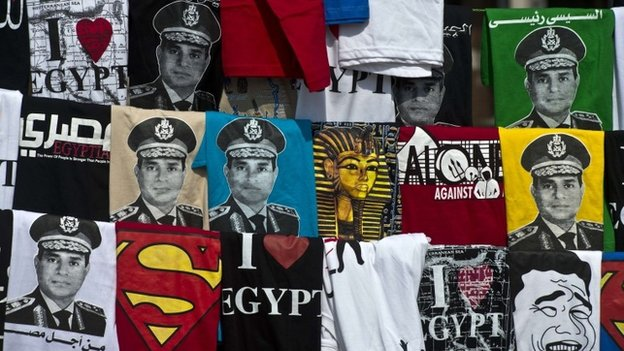Shirts, some depicting Abdel Fattah al-Sisi, is displayed for sale on Tahrir Square during a gathering marking the 40th anniversary of the 1973 Arab-Israeli war on October 6, 2013 in the Egyptian capital Cairo. Egypt braced for rival demonstrations called by supporters and opponents of deposed Islamist president Mohamed Morsi during the anniversary's festivities. AFP PHOTO / KHALED DESOUKIKHALED DESOUKI/AFP/Getty Images