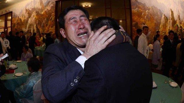 South Korean Park Yang-gon, 53, and his North Korean brother Park Yang-su, cry during their family reunion at the Mount Kumgang resort in North Korea