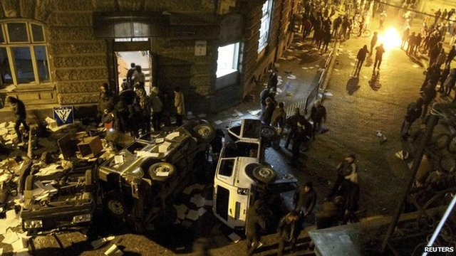 Anti-government protesters outside the district police department in Lviv.