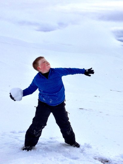 Toby throwing a snowball
